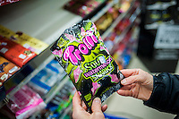 A shopper chooses a bag of Ferrrara Candy Co.'s Trolli Watermelon Sharks candy in a supermarket in New York on Friday, December 9, 2016. Media reports that the former CEO of Hershey's David West, is close to acquiring Ferrara Candy Co. in a $1.5 billion deal. (© Richard B. Levine)