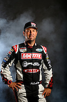 Mar. 21, 2014; Chandler, AZ, USA; LOORRS pro 2 driver Jeremy McGrath poses for a portrait prior to round one at Wild Horse Motorsports Park. Mandatory Credit: Mark J. Rebilas-USA TODAY Sports