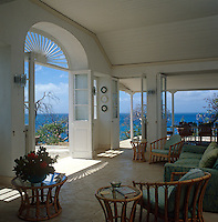 This airy living area has folding doors on two sides of the room which open to spectacular views of the surrounding sea