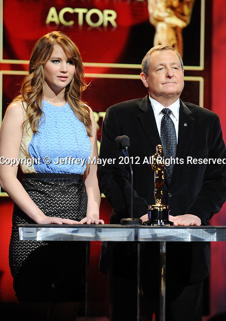 BEVERLY HILLS, CA - JANUARY 24: Jennifer Lawrence and Tom Sherak announce the nominees during the 84th Academy Awards Nominations Announcement at AMPAS Samuel Goldwyn Theater on January 24, 2012 in Beverly Hills, California.