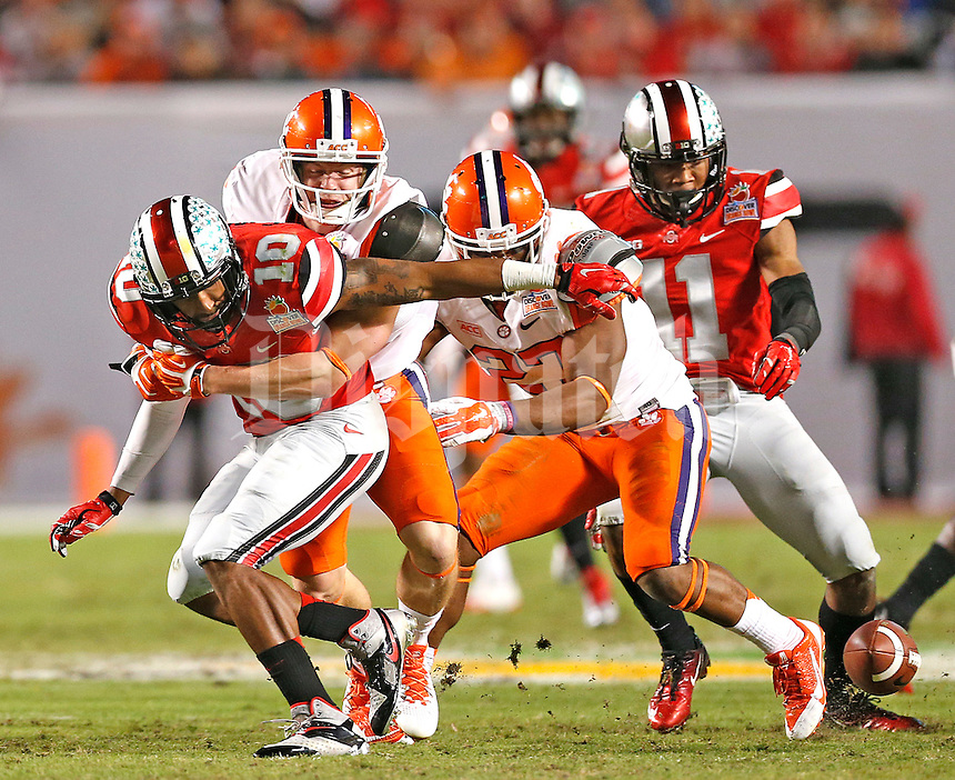 Ohio State Buckeyes wide receiver Philly Brown (10) loses the ball on a punt in the third quarter setting up a Clemson TD at the 2014 Discover Orange Bowl at Sun Life Stadium in Miami Gardens, Florida on January 3, 2014. (Chris Russell/Dispatch Photo)