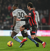Bournemouth's Adam Smith (right) vies for possession with West Ham United's Michail Antonio (left) <br /> <br /> Photographer David Horton/CameraSport<br /> <br /> The Premier League - Bournemouth v West Ham United - Saturday 19 January 2019 - Vitality Stadium - Bournemouth<br /> <br /> World Copyright © 2019 CameraSport. All rights reserved. 43 Linden Ave. Countesthorpe. Leicester. England. LE8 5PG - Tel: +44 (0) 116 277 4147 - admin@camerasport.com - www.camerasport.com
