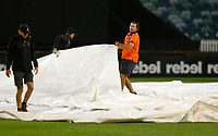 1st November 2019; Western Australia Cricket Association Ground, Perth, Western Australia, Australia; Womens Big Bash League Cricket, Perth Scorchers versus Melbourne Renegades; WACA ground staff roll out the covers during a rain delay after two overs of the Scorchers innings