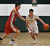 Thornton Scott #3 of Holy Trinity, right, gets pressured by Thomas Catalano #23 of St. John the Baptist during a Nassau-Suffolk CHSAA varsity boys basketball game at Holy Trinity High School on Friday, Feb. 3, 2017.