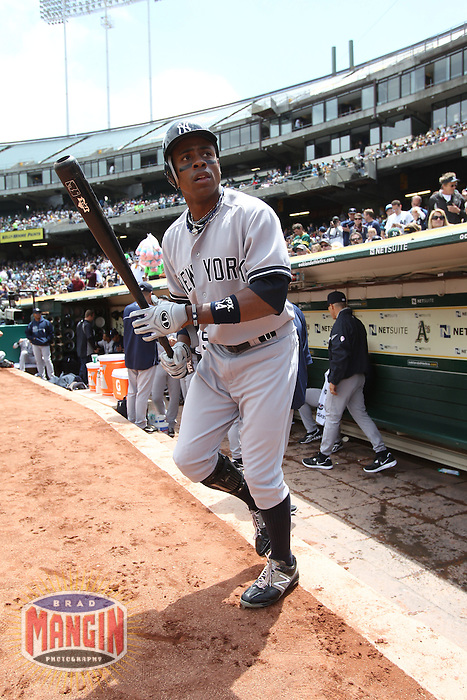OAKLAND, CA - MAY 26:  Curtis Granderson #14 of the New York Yankees walks out of the dugout before the game against the Oakland Athletics at O.co Coliseum on Saturday May 26, 2012 in Oakland, California. Photo by Brad Mangin