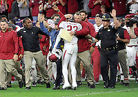 NWA Media/Michael Woods --12/29/2014-- w @NWAMICHAELW...University of Arkansas coach Bret Bielema gets a hug from Tevin Mitchel as players celebrate their 31-7 win over the University of Texas at the Texas Bowl Monday night at  NRG Stadium in Houston.