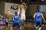 SIOUX FALLS, SD - MARCH 8:  David Anderson #21 of Governors State shoots over Jason Spicer #40 of Dakota Wesleyan at the 2018 NAIA DII Men's Basketball Championship at the Sanford Pentagon in Sioux Falls. (Photo by Dick Carlson/Inertia)