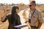 Cheetah (Acinonyx jubatus) biologists, Kim Young-Overton and Luke Hunter, during transect, Kafue National Park, Zambia