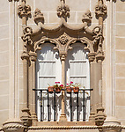 Architectural detail of Manueline historic window frame in old building city of Evora, Alto Alentejo, Portugal