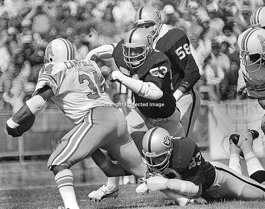 Raiders Rod Martin, Ted Hendricks a nd Monte Johnson stop Houston Oiler Earl Campbell..(1977 photo/Ron Riesterer)