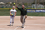 Western Nevada College's Carlee Beck watches Carson City Sheriff Kenny Furlong throw the ceremonial first pitch before a game against the College of Southern Nevada on Friday, May 2, 2014, in Carson City, Nev. <br /> Photo by Cathleen Allison/Nevada Photo Source