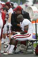 FORT WORTH, TX - SEPTEMBER 13:  Dr. Jason Dragoo talks with Rob Dalnoki who is examing Wopamo Osaisai of the Stanford Cardinal during Stanford's 31-14 loss to the TCU Horned Frogs on September 13, 2008 at Amon Carter Stadium in Fort Worth, Texas.