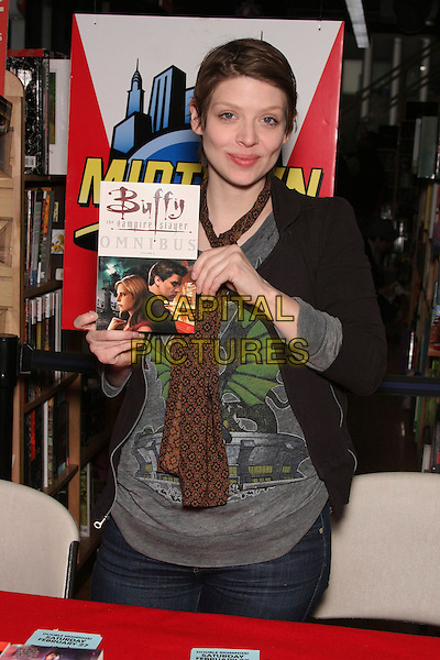 "AMBER BENSON.at the Book Signing for ""Cat's Claw"" at Midtown Comics Times Square, New York, NY, USA, .February 27th, 2010..half length brown scarf  black grey gray top jacket holding .CAP/LNC/TOM.©LNC/Capital Pictures"