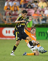 Houston Dynamo midfielder Richard Mulrooney (30) tackles Columbus Crew forward Ricardo Virtuoso (25). The Houston Dynamo tied the Columbus Crew 1-1 in a regular season MLS match at Robertson Stadium in Houston, TX on August 25, 2007.