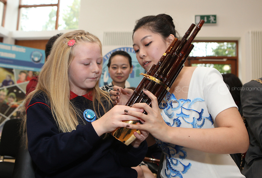 09/09/2011.Jodi Brennan 11.From St Joseph's Senior School, Ballymun, Dublin  & Chineese musican Fang Yuan in traditional Chinese costume during a vist by the musicans to the school  marking the official Irish visit of the Lord Mayor of Beijing, taking place this weekend.Photo: Collins