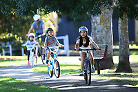 1st April 2020, Kohi Beach, Auckland, New Zealand;  A cycling family make the most of the warm weather during the lockdown due to Covid-19. Kohimarama, Auckland, New Zealand on Wednesday 1 April 2020.