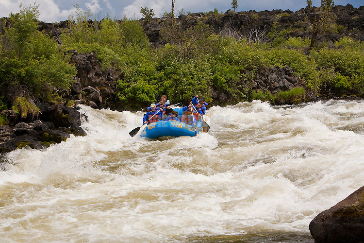 White water rafting on Deschutes River near Bend, Oregon.  Big Eddy rapid is a class 4 rapid