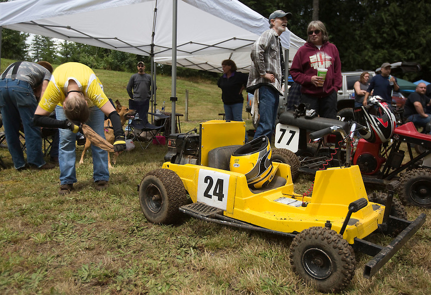 "Brenda Olstad (L) gets ready for a lawnmower race at the annual ""Territorial Days"" festival in Amboy Sunday July 10, 2016. Other events during the celebration included a logging show, musical performances, an art show and a carnival. The celebration highlights the area's connection to logging and pioneering.  (Photo by Natalie Behring/ for the The Columbian)"