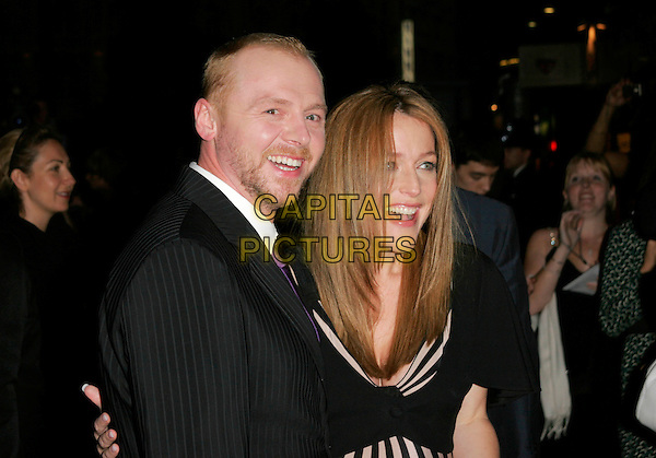 "SIMON PEGG & GILLIAN ANDERSON.At the UK Film Premiere of ""How To Lose Friends And Alienate People"" at the Empire Leicester Square, London, England, September 24th 2008..half length black suit dress pregnant beard stubble facial hair .CAP/AH.©Adam Houghton/Capital Pictures"
