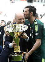 Calcio, Serie A: Juventus - Hellas Verona, Torino, Allianz Stadium, 19 maggio, 2018.<br /> Juventus' Captain and goalkeeper Gianluigi Buffon (r) and Juventus CEO Giuseppe Marotta (l) celebrate with the trophy during the victory ceremony following the Italian Serie A football match between Juventus and Hellas Verona at Torino's Allianz stadium, 19 May, 2018.<br /> Juventus won their 34th Serie A title (scudetto) and seventh in succession.<br /> Gianluigi Buffon played his last match with Juventus today after 17 years.<br /> UPDATE IMAGES PRESS/Isabella Bonotto