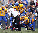 BROOKINGS, SD - OCTOBER 5:  Doug Peete #34 and Bryan Burke #55 from South Dakota State University combine for a sack on Kory Faulkner #19 from Southern Illinois in the second quarter Saturday afternoon at Coughlin Alumni Stadium in Brookings. (Photo by Dave Eggen/Inertia)