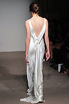 Model walks runway in Rita - a bias envers satin gown with draped back neckline, from the Anna Maier Couture Collection 45 by Charles W. Bunstine II, at 32 West 39 Street on April 17, 2016 during New York Fashion Week Spring Summer 2017.