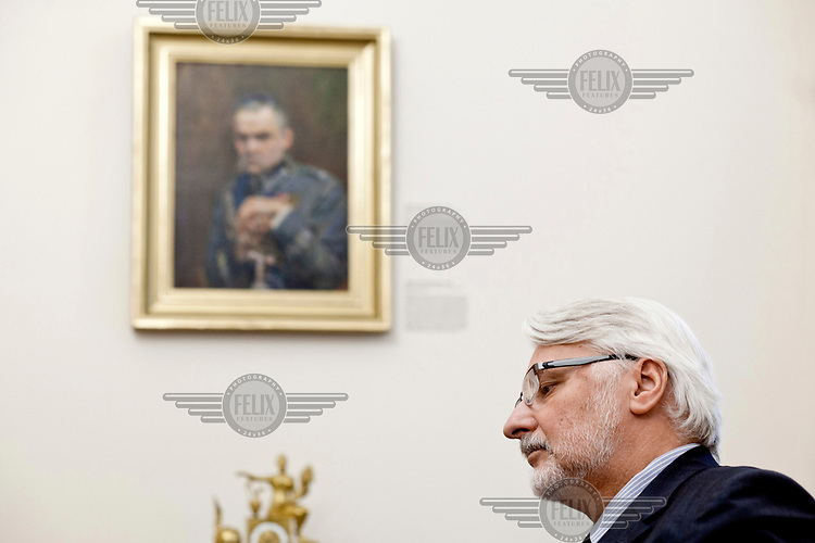 Foreign affairs minister Witold Waszczykowski in his office beside a portrait of Jozef Pilsudski.