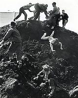 "Kids playing ""King of the Mountain"" on pile of dirt at the site of Ground- Breaking ceremonies for a Naval Reserve Center in Albany, Ca (1965 photo by Ron Riesterer)"