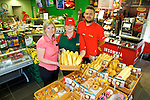 Teresa Delaney and Hannah Langan with owner Norman Foley at Spar Milltown