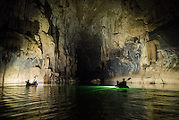 Kayakers paddle through a large passage, known as the cathedral passage, in Xe Bang Fai River Cave (Tham Khoun Xe) in Laos.