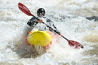 A kayaker paddles the whitewater on the Gallatin River near House Rock rapid north of Big Sky, Montana.