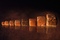 Cubical chert weights used for weighing goods for sale.  Indus valley had an elaborate system of trade.  These weights are often found at the gates of cities where merchants may have been taxed.  4,800 years ago, at the same time as the early civilizations of Mesopotamia and Egypt, great cities arose along the flood plains of the Indus and Saraswati (Ghaggar-Hakra) rivers.  Developments at Harappa have pushed the dates back 200 years for this civilization, proving once and for all, that this civilization was not just an offshoot of Mesopotamia..They were a highly organized and very successful civilization.  They built some of the world's first planned cities, created one of the world's first written languages and thrived in an area twice as large as Egypt or Mesopotamia for 900 years (1500 settlements spread over 280,000 square miles on the subcontinent)..There are three major communities--Harappa, Mohenjo Daro, and Dholavira. The town of Harappa flourished during this period because of it's location at the convergence of several trade routes that spanned a 1040 KM swath from the northern mountains to the coast.