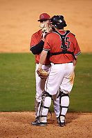 Ball State Cardinals relief pitcher Matt Haro (26) talks with catcher Jarett Rindfleisch (25) during a game against the Wisconsin-Milwaukee Panthers on February 26, 2016 at Chain of Lakes Stadium in Winter Haven, Florida.  Ball State defeated Wisconsin-Milwaukee 11-5.  (Mike Janes/Four Seam Images)