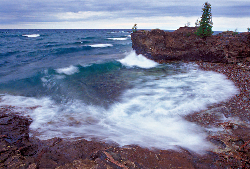 Lake Superior waves work on the rugged coast of Presque Isle Park in Marquette, Michigan.