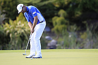 Padraig Harrington (IRL) putts on the 18th green during Friday's Round 2 of the 2014 Irish Open held at Fota Island Resort, Cork, Ireland. 20th June 2014.<br /> Picture: Eoin Clarke www.golffile.ie