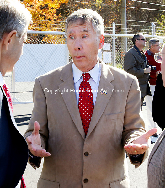 PLYMOUTH CT. 26 October 2015-102615SV12-Mayor David Merchant, town officials and company executives participate in a flag-raising ceremony for the soft opening of Inland Fuels, a propane distribution company that will become the town's second largest taxpayer, in Plymouth Monday.<br /> Steven Valenti Republican-American
