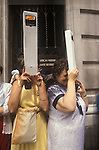 Royal Wedding of Prince Charles ands Lady Diana Spencer, two women using souvenir periscopes to look over the crowd of to view the ceremony  London Uk