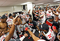 Ohio State Buckeyes players celebrate in the locker room after beating  Alabama Crimson Tide 42-35 in the Allstate Sugar Bowl college football Playoff Semifinal game at the Mercedes-Benz Superdome in New Orleans, Louisiana on January 1, 2015.  (Dispatch photo by Kyle Robertson)