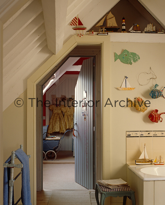A child's bathroom has been built under the eaves of this converted Gloucestershire cowshed