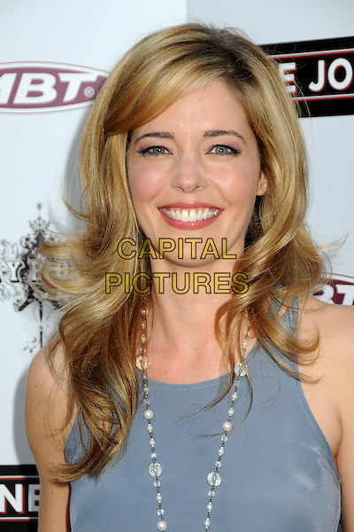 "CHRISTINA MOORE .""The Joneses"" Los Angeles Premiere held at Arclight Cinemas, Hollywood, California, USA, 8 April 2010..arrivals portrait headshot smiling grey gray vest top  necklace .CAP/ADM/BP.©Byron Purvis/AdMedia/Capital Pictures."