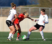 Lisa De Vanna of the Washington Freedom is fouled by Nikki Krzysik of the Philadelphia Independence as her teammate Jennifer Buczkowski moves in during their preseason game at the Maryland SoccerPlex in Germantown, Maryland.