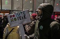 NEW YORK, NY - JANUARY 28: A man holds a sign during a demonstration against the Muslim immigration ban at John F. Kennedy International Airport on January 28, 2017 in New York City. President Trump signed an executive order to suspend refugee arrivals and people with valid visa from Iran, Iraq, Libya, Somalia, Sudan, Syria and Yemen. Photo by VIEWpress/Maite H. Mateo.