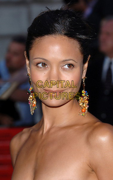 "THANDIE NEWTON.The Premiere of ""Volver"", Curzon Mayfair, London, UK..August 3rd, 2006.Ref: BEL.headshot portrait dangling earrings.www.capitalpictures.com.sales@capitalpictures.com.©Tom Belcher/Capital Pictures."