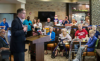 NWA Democrat-Gazette/BEN GOFF @NWABENGOFF<br /> Cpl. Aaron Mankin, a U.S. Marine Corps veteran, speaks Tuesday, June 4, 2019, during a pinning ceremony for military veterans at Primrose Retirement Communities Assisted Living in Rogers. Mankin, who works with congressman Steve Womack's office, thanked veterans and shared his story of surviving a bomb blast in Iraq in 2015. The program recognized 32 local veterans, most of whom are residents of the facility. The recognition is part of Arkansas Hospice's We Honor Veterans campaign to pay respect to veterans in their later years.