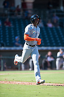 Salt River Rafters center fielder Monte Harrison (4), of the Miami Marlins organization, jogs towards first base after drawing a walk during an Arizona Fall League game against the Surprise Saguaros on October 9, 2018 at Surprise Stadium in Surprise, Arizona. The Rafters defeated the Saguaros 10-8. (Zachary Lucy/Four Seam Images)
