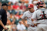 Coach Sunny Galloway of the Oklahoma Sooners talks to the umpire in the game against the Texas Longhorns in NCAA Big XII baseball on May 1, 2011 at Disch Falk Field in Austin, Texas. (Photo by Andrew Woolley / Four Seam Images)