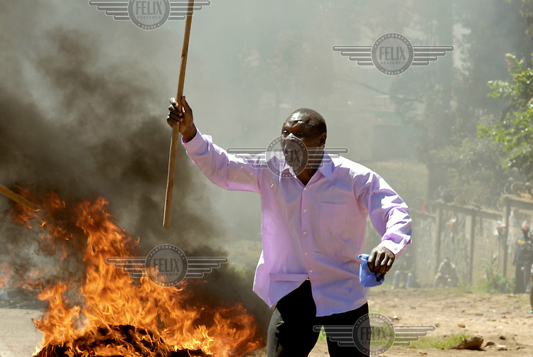 Rioters set fires to block a road in the Kibera slum. Supporters of the opposition Orange Democratic Movement (ODM), who are popular in Kibera, led protests against suspected vote rigging after disputed election results, leading to unrest and violence.