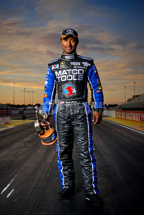 Sept. 5, 2011; Claremont, IN, USA: NHRA top fuel dragster driver Antron Brown poses for a portrait after winning the US Nationals at Lucas Oil Raceway. Mandatory Credit: Mark J. Rebilas-