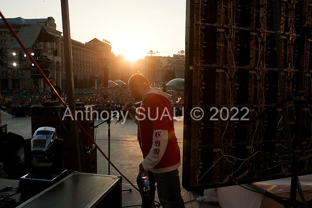 "Kiev, Ukraine.May 29, 2005 ..Kiev day, a party in the city center. Roman Kalin, the lead singer for the band Greenjolly, takes the stage. The band is the Ukrainian revolutionary band who's song, Razom Nas Bahato was used during the ""Orange Revolution"" and also the Ukrainian representing song in the Eurovision contest.."