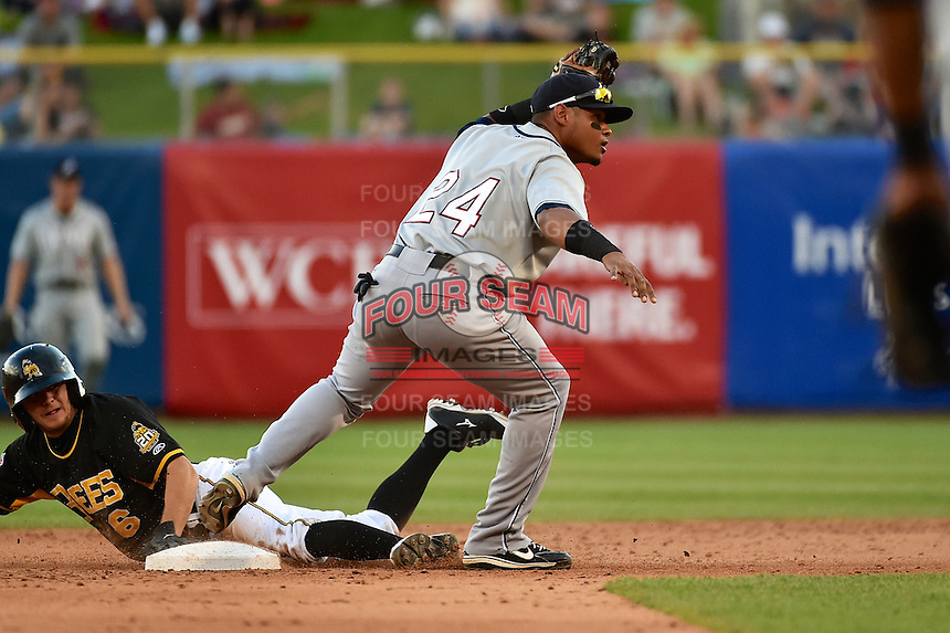 Argenis Diaz (24) of the Reno Aces on defense against the Salt Lake Bees in Pacific Coast League action at Smith's Ballpark on July 23, 2014 in Salt Lake City, Utah.  (Stephen Smith/Four Seam Images)
